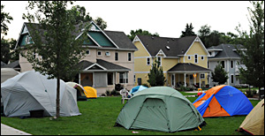 Half a dozen tents pitched on the lawn
