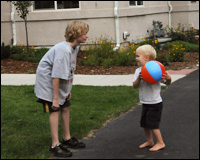 Two children playing with a beach-ball